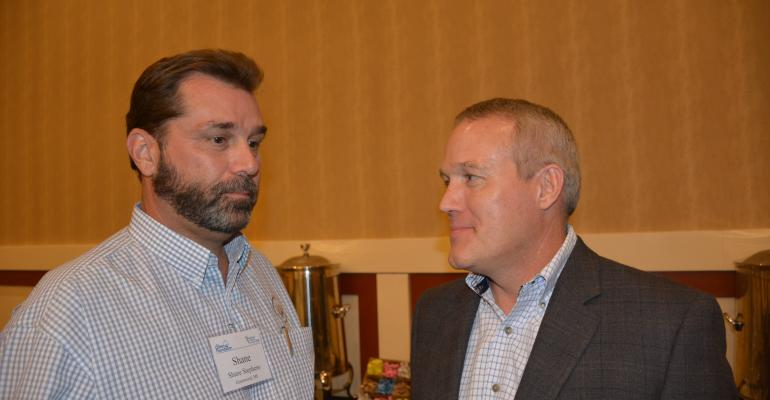 Shane Stephens left  NCC chairman chats with Roger Zey John Deere prior to the American Cotton Producers Cotton Foundation joint summer meeting in Lubbock