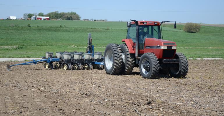 Larry Mueller plants soybeans with Kinze 2500 planter