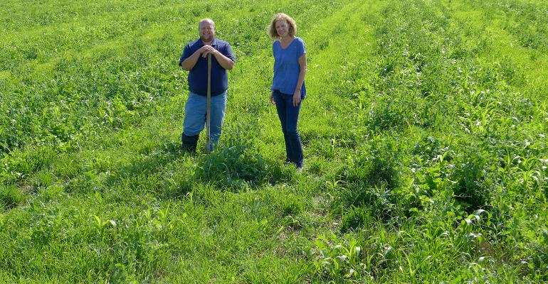 Becky Wagner, right, and Josh Hiemstra standing in green field