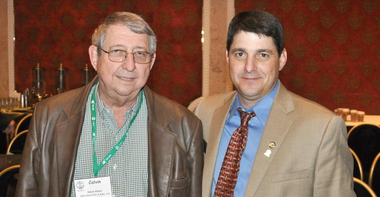 Louisiana crop consultant Calvin Viator and his son Blaine visit between sessions of the National Alliance of Independent Crop Consultants in Reno Nev