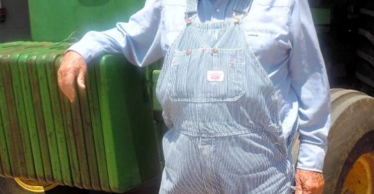 ROBBIE ROBBINS wears Round House overalls every day Farming more than 6000 acres of cotton each year in southwestern Oklahoma Robbins and his son Danny are officers in the farmerowned cooperatives which buy and sell raw cotton and its products in the Rolling Plains of North Texas Oklahoma and Kansas