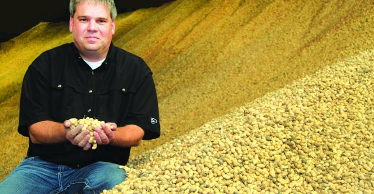 A PEANUTS MOUNTAIN Brian Atkins checks on 2011crop peanuts at Birdsong Peanuts Prairie Miss The companyrsquos 13 million facility expects to handle 24000 to 30000 tons of peanuts this year