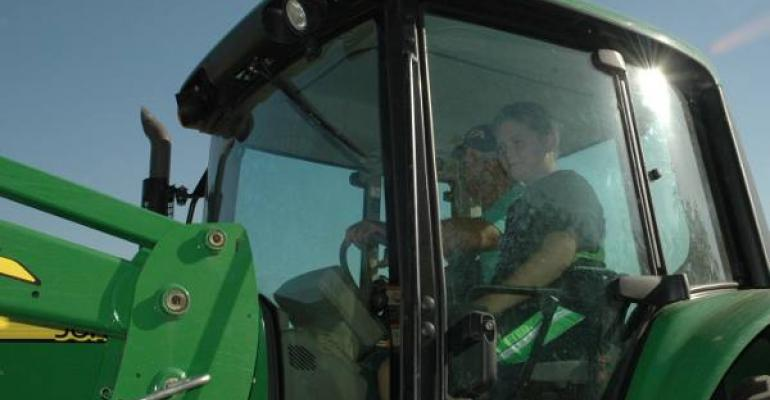 In early August in near 100degree heat Larry Lambert and his grandson Noah cut hay near Weston north of Dallas