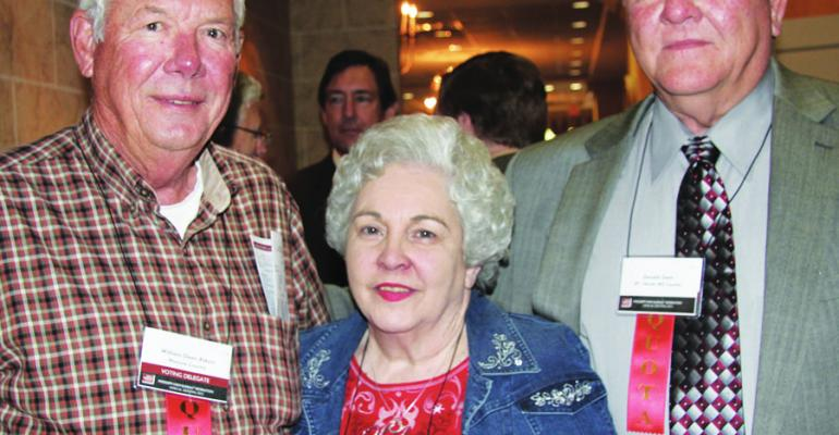 WILLIAM DEAN ATKINS left and his wife Jeanette Monroe County peanut and grains producers visited with Donald Gant Bolivar County rice and grains producer at the annual meeting of the Mississippi Farm Bureau Federation