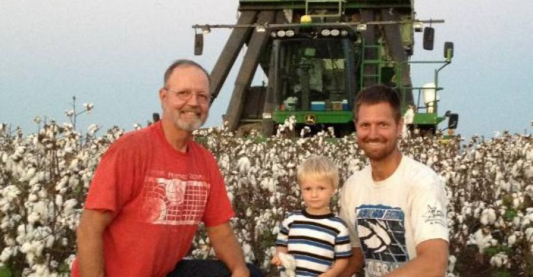 CEDRIC POPP left son Michael and grandson Hayden are shown in a cotton field that yielded 375 bales per acre thanks in part Michael says to variable rate application technology The cotton picker is equipped with a yield monitor