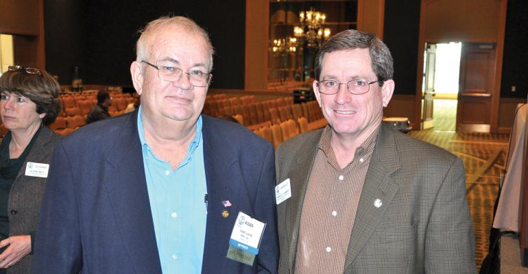 Retired Louisiana consultant Roger Carter left Navarre Fla visits with Harold Lambert Lambert Agricultural Consulting Inc Ventress La at the National Alliance of Independent Crop Consultants annual meeting in Jacksonville Fla