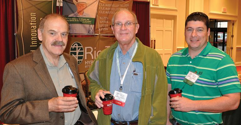 From left Derrick Oosterhuis professor of cotton physiology at the University of Arkansas Joe Townsend Townsend Ag Consulting Coahoma Miss and John David Bassie Valent Brandon Miss visit during the Conservation Systems Cotton and Rice Conference in Baton Rouge La