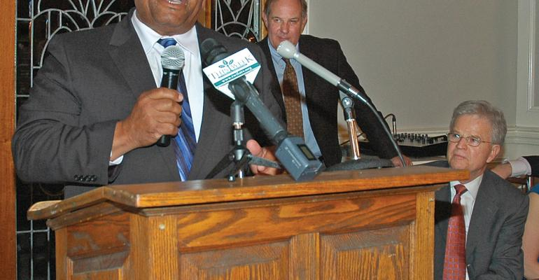 HARPER ARMSTRONG OF Bastrop La addresses the group gathered at a banquet in Baton Rouge La to honor some of Louisianarsquos top farmers Armstrong was named the 2013 Farmer of the Year Bill Richardson chancellor of the LSU AgCenter center presented the award Buddy Roemer former Louisiana governor seated was the guest speaker at the event Photo by Linda Foster Benedict