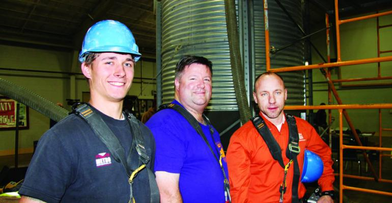 SUITED FOR SAFETY from left Tanner Weaver Strayhorn Miss Dan Neenan director the National Education Center for Agricultural Safety at Northeast Iowa Community College and Chris Shivers Mississippi Farm Bureau Federation are ready to conduct a grain bin rescue demonstration