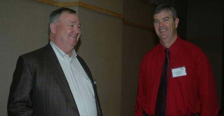 NCC President and CEO Mark Lange left and Joe Outlaw Professor and Texas AgriLife Extension economist discuss farm bill progress during a break at the recent Concho Valley Cotton Conference in San Angelo