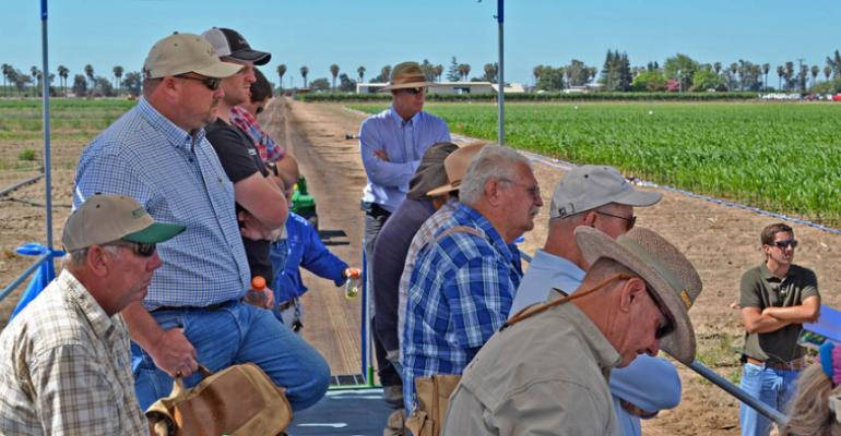 PCAs and growers take notes on the stops of the tour of the Bayer CropScience research farm recently