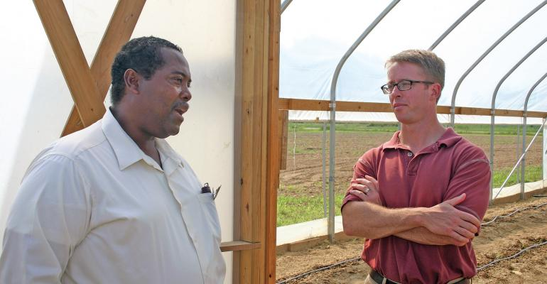 NEW NRCS CHIEF Jason Weller right toured Arkansas in late August At a stop outside Marianna he heard about hoop house technical assistance from Julius Hancock farm manager for the University of ArkansasPine Bluff Farms