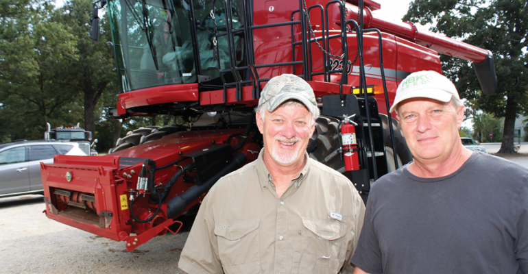 MIKE PANNELL left and his brother Mark were expecting to be harvesting their 2000 acres of soybeans in late September Mark had just finished washing and cleaning their combine to spitshine showroom condition when the photo was made