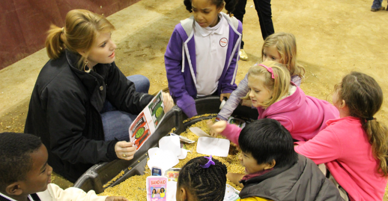 SAMANTHA LAIRD Mississippi Farm Bureau Federation explained to third graders how soybeans are grown and used for food animal feed and a host of other uses She was one of several volunteers participating in the second annual Farmtastic event at Mississippi State University