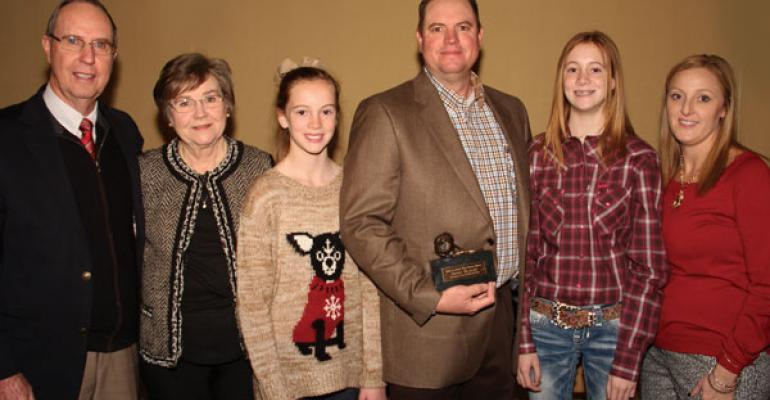 BOB BEAKLEY left and Linda Beakley were on hand with granddaughters Mattie Beakley third from left and Audrey Beakley second from right and their mom Amber Beakley to see Steven Beakley receive the 2014 High Cotton Award for the Southwest