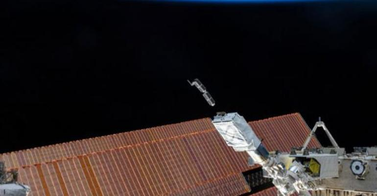 Two tiny Planet Labs satellites float above an International Space Station solar panel after being launched in January The satellites are part of a planned 100plus satellite constellation that will be able capture daily images of the entire earth