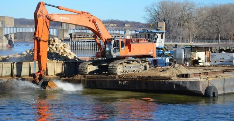 A crane places stone riprap along the navigation channel in the Mississippi River at Lock 3 near Red Wing MN  Jan 10 The US Army Corps of Engineers completed the extension of Lock and Dam 3rsquos upper guide wall in 2012 as part of a 71 million renovation project