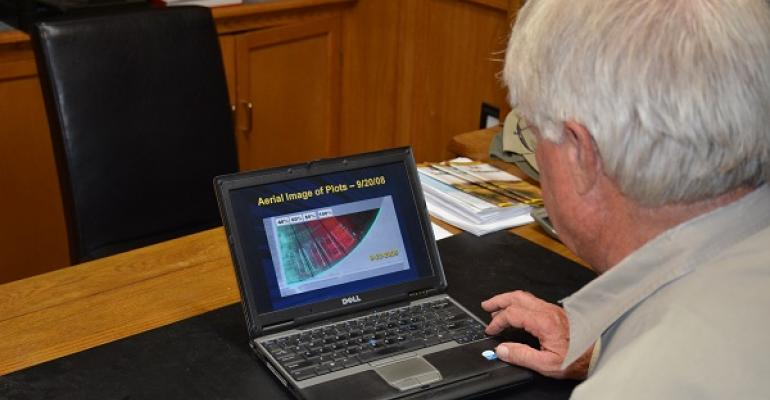 BOB GLODT president of AgriSearch in Plainview Texas reviews computer images showing varietywater efficiency research