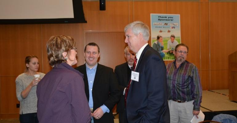 Michael Swanson Wells Fargo Bank chats with participants at the recent OSU Rural Economic Outlook conference in Stillwater Okla