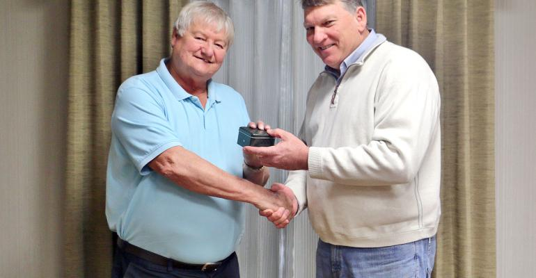 KEN VINES Goldman Equipment president presents a watch to Bob Castilaw in recognition of Castilawrsquos 50 years with the company