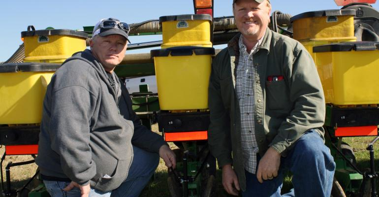 GEORGIA farmer Keith Bowen right and his employee David Shattles fitted Bowenrsquos cotton planter with a sprayer system to put residual herbicide out as the planter runs across the field this spring just one of many small adjustments Bowen hopes will add up to make a tough pricing year profitable for his farming operation