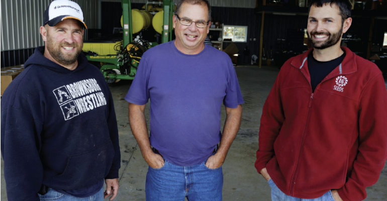 Mike Starkey center handles the daily management at MampJ Farms along with his nephew Jeff Starkey right and employee AJ Adkins