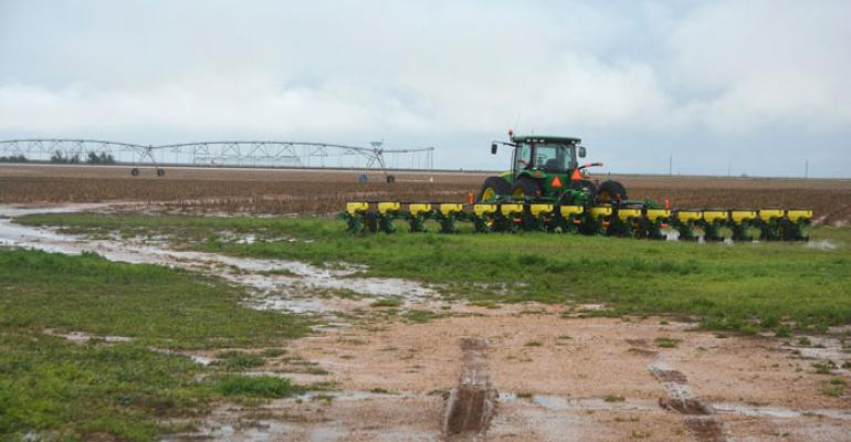 MUD keeps tractors idle Farm equipment is idled as field work is shut down by the rains