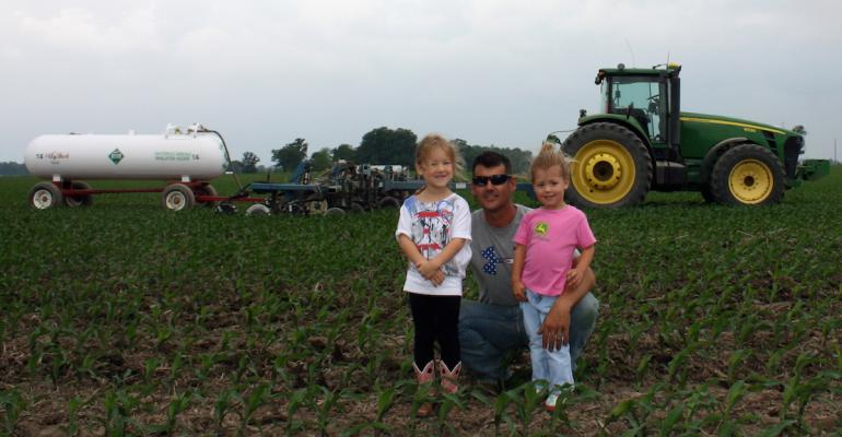 Rhett Light with daughters Raygan left and Kaylin right sidedresses about 90 of his cornrsquos N so making the variablerate N applications recommended by the Pioneer program was straightforward
