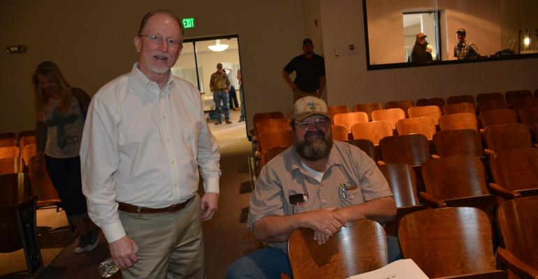 Randy Boman left OSU Extension state cotton lead chats with Dennis Greteman Burns Flat Okla at the Carnegie Cooperative Cotton Conference