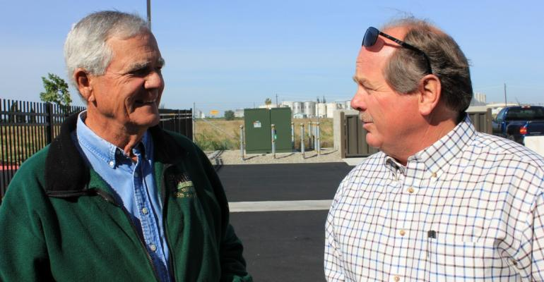 Bill Chandler left Fresno County wine grape grower talks with Steve Schafer grower and vintner with San Joaquin Wine Co during a break at a grower quottailgatequot meeting in Madera Calif
