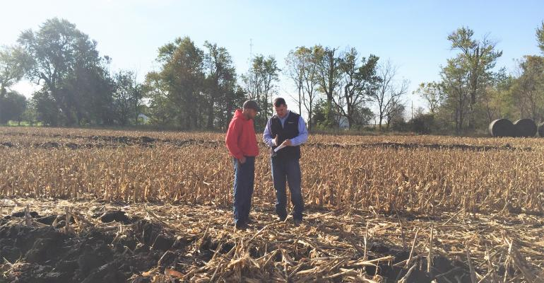 Continued demand for farmland by local operators like Brayton Turner left are helping to maintain rates suggests Professional farm manager Matt Clarahan right Turner will be operating a farm managed by Clarahan for the first time in 2017 Here the two are reviewing a modified crop share lease and discussing newly installed drainage tile on the farm