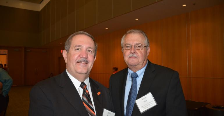Mike Woods head of the Oklahoma State University Agricultural Economics Department greets speaker Terry Barr at the recent OSU Rural Economic Outlook
