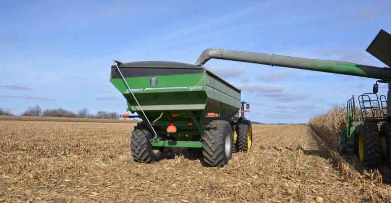 grain cart being filled during harvest