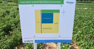 sign in front of crop field
