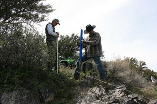 Building electric fence in rough country