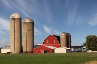 Farm scene featuring silos and red barn