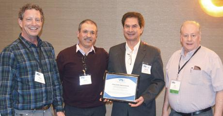 Ples Spradley, The Pesticide Stewardship Alliance awards chair, honors Ofelio Borges, Manuel Ornelas and Joe Hoffman, WSDA, with the Program Innovation Award
