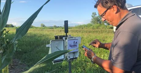 Mike Thurow adjusts the weather station on the Spangler farm