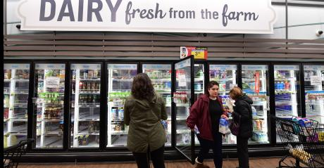 People shop for dairy products at a supermarket