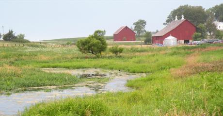 creek and red barn and farmland
