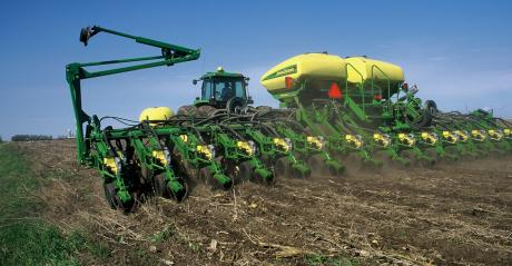 John Deere planter in field