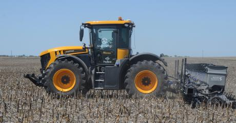 : Sabanto's Craig Rupp and Kyler Laird are both in the cab of this JCB Fastrac. But look closely, and you'll notice that there are no hands on the steering wheel – the tractor is driving itself, pulling an 18-row Harvest International planter, planting so