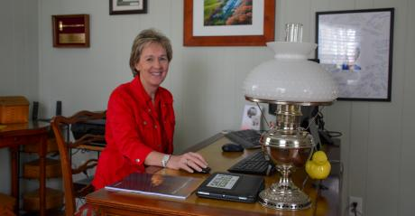 Jenny Rhodes, owner of Deerfield Farm in Centreville, Md. in her home office