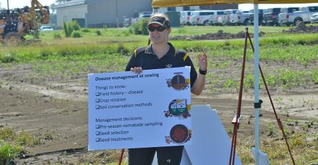 Kaitlyn Bissonnette, MU Extension plant pathologist, speaks at field day