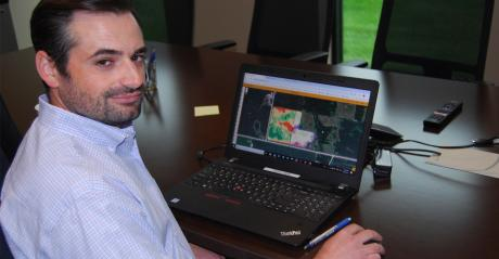 Ben Johnson with laptop showing field mapping