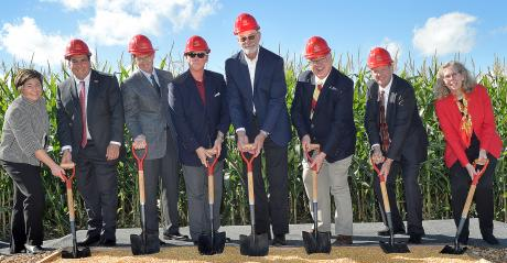officials breaking ground for a feed mill