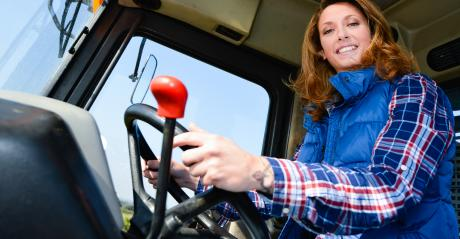 young woman driving tractor