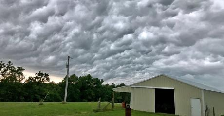 ominous storm clouds over rural shed