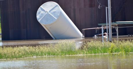 container carried downstream due to flooding