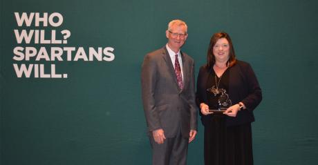 Apple Committee Executive Director Diane Smith receives the MSU Extension Key Partner Award from Ron Hendrick